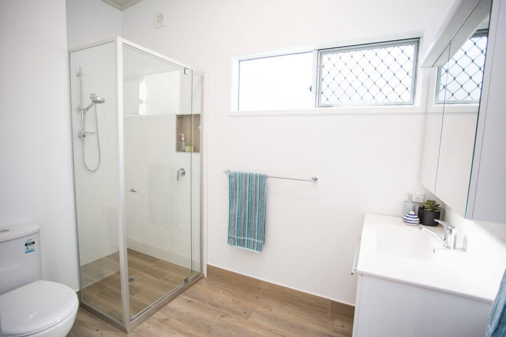 Spacious bathroom with oversized shower and built in niche